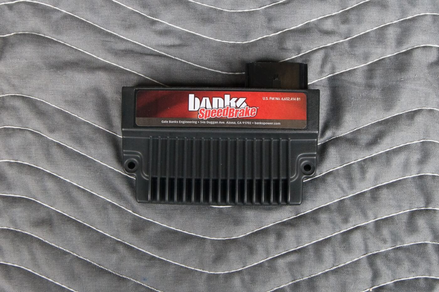 2. Here's the brains behind the SpeedBrake, and it mounts safely under the hood. The SpeedBrake can be used as a freestanding unit or for even more control, it can be connected to the Banks iQ tuner.