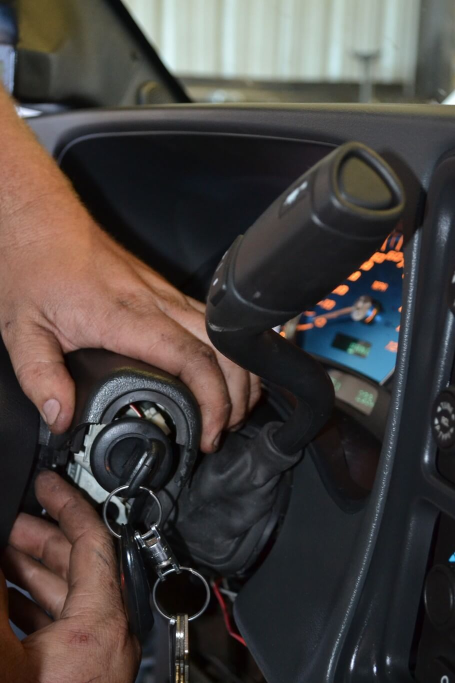 6. After the new shifter is installed, the steering column cover is snapped back into place. We were careful not to catch or pinch the rubber shifter boot on anything at this point in the install.