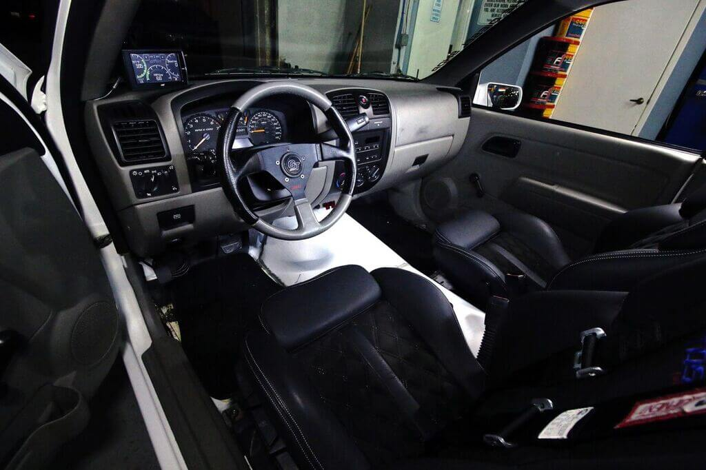 The interior is mainly stock outside a few modifications. the transmission tunnel was redone to give room for the new Allison 1000. A GT steering wheel was installed, as was an Edge CTS to monitor engine vitals.