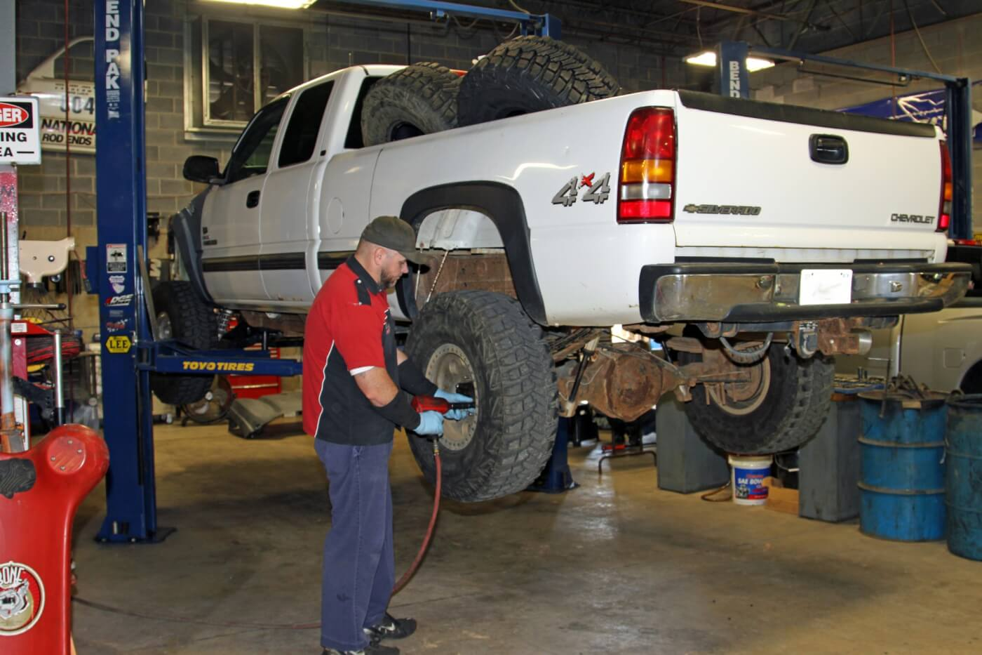 1. To start the Ultimate Rear Axle Build Jason Nelson puts the big Duramax truck on one of the twin post lifts in the RPM Offroad service bay and then removes the rear wheels.
