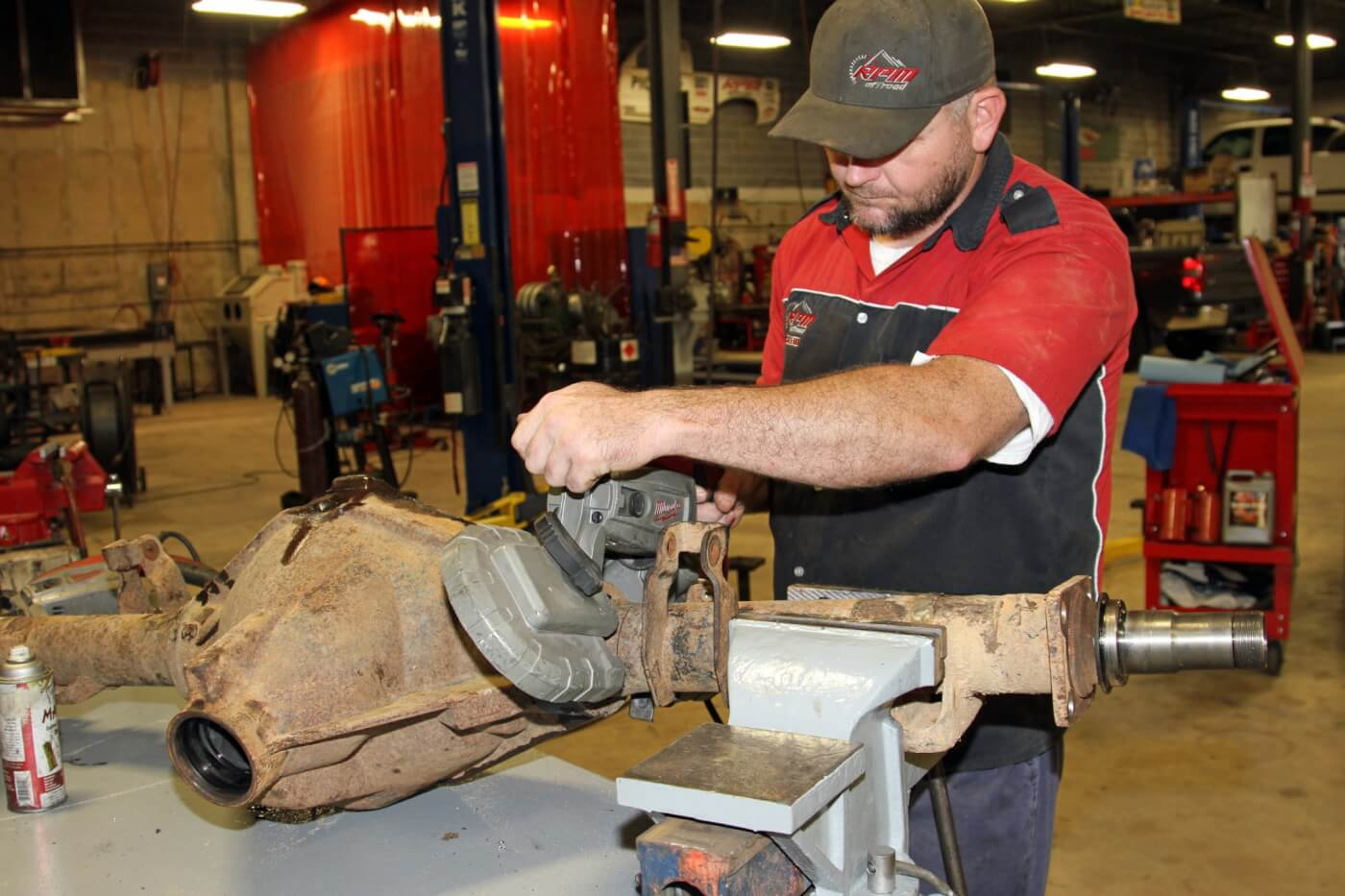 11. After taking careful measurements to determine the leaf spring pad location as well as the precise axle tube length Nelson uses a portable band saw to cut the axle tubes. The saw makes quick work of the 1/4-inch thin wall tubing.