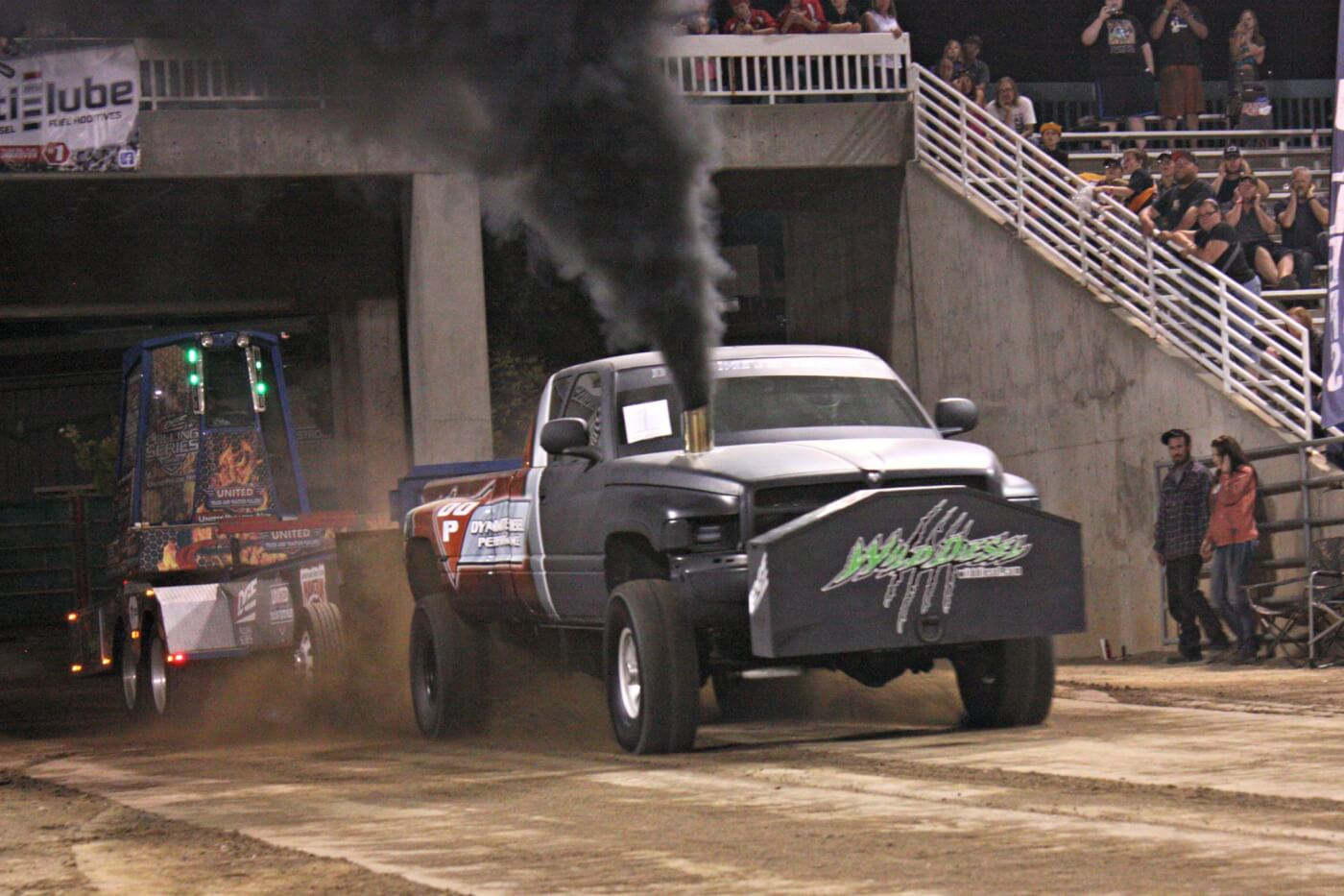 Trevor Larkin, a mechanic for nearby Wild Diesel, runs this big dually 12V Cummins in the 3.0 Inducer class. His 272.28-foot pull snagged third place, just 4 feet shy of the winner.