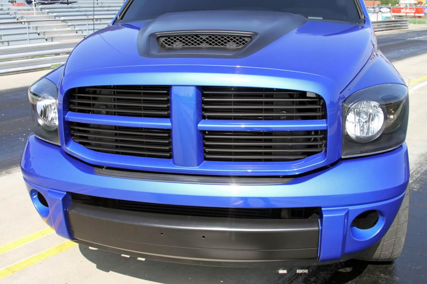 After the collision damage was repaired Rose chose to go with an SRT10 hood, grille and bumper for better looks on the truck. Notice that they also filled the Dodge emblem in the grille for a smooth clean look.