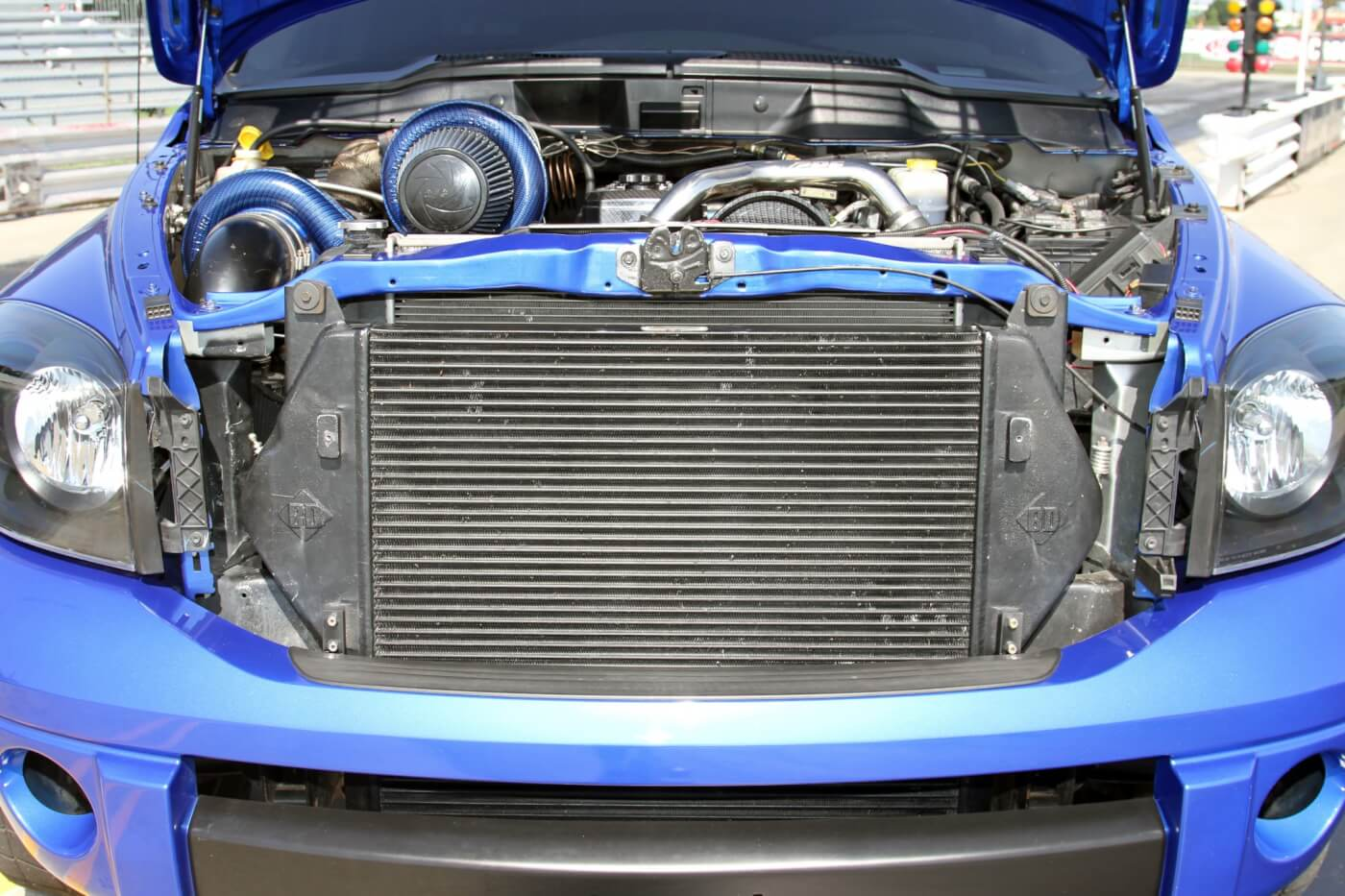 A BD Diesel intercooler is used to cool the intake charge after the three turbos build boost.