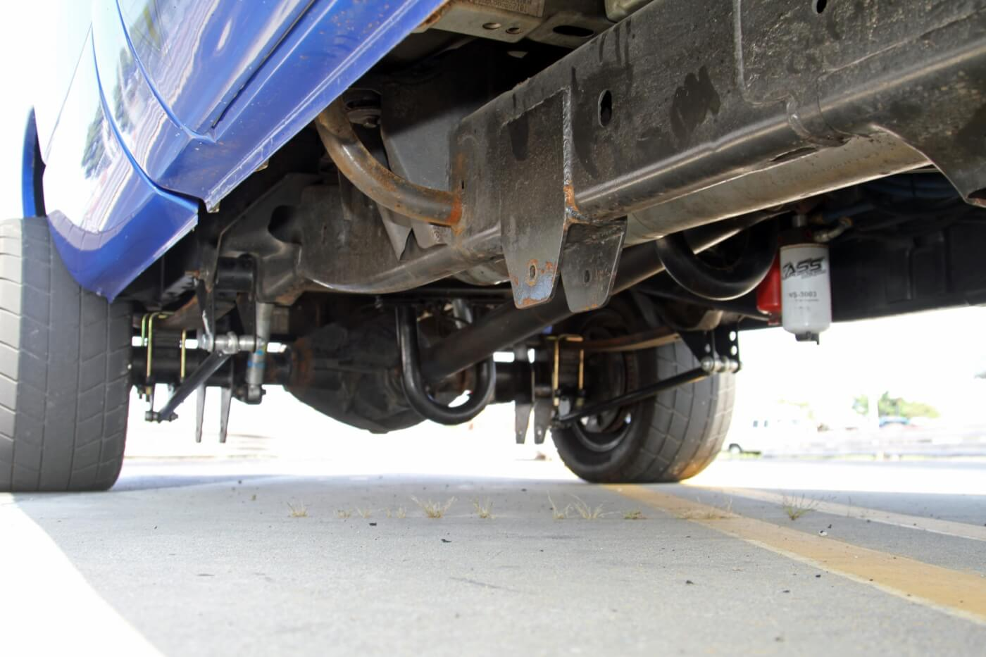 Looking under the truck you can see one connection point of the roll cage to the frame as well as the driveshaft hoops, CalTracs traction bars and FASS fuel pump.