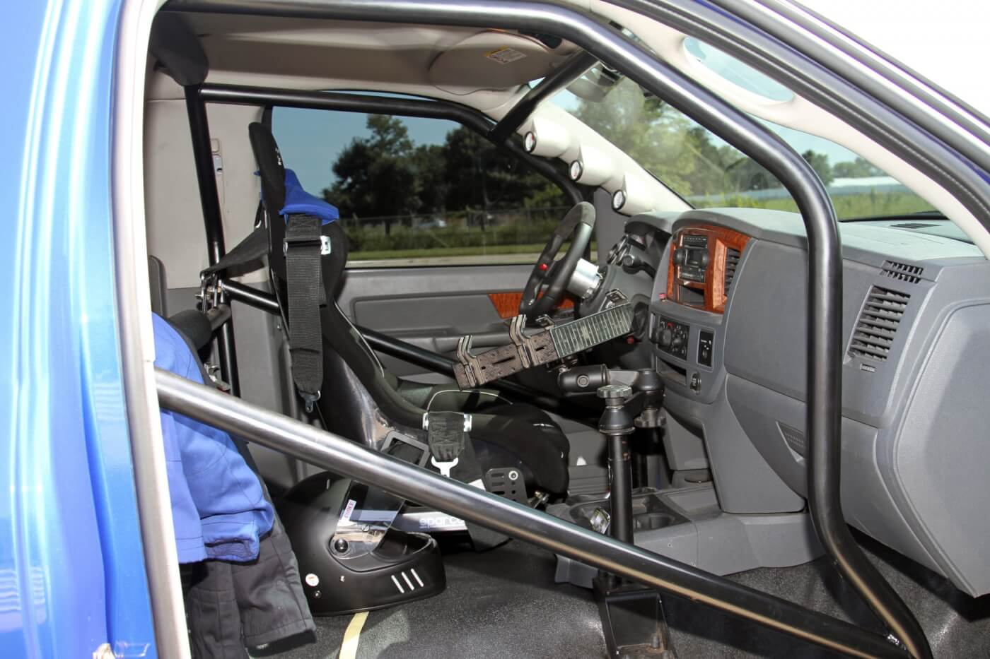 With a vinyl floor, roll cage and a single racing seat you can easily tell that Rose's truck is ready to rumble. The Ram Mount holds his laptop while data logging during runs or while tuning the truck.