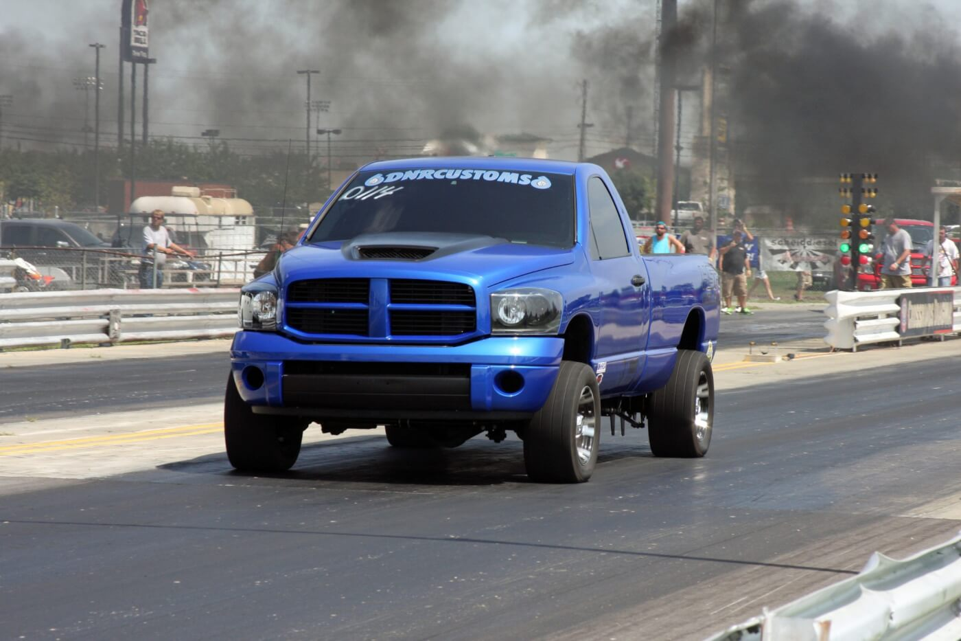 Derek Rose blasts down the track at the 2014 Scheid Diesel Extravaganza on the way to a win in the 6.60 Index class.