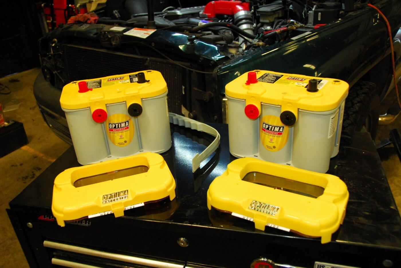 1. Optima's YellowTop model is recommended for diesel applications, since it's a dual-purpose battery. That means it not only provides plenty of CCA for firing up an older diesel engine, but also offers effective cycling capability as well, so that it can repeatedly be brought back from deep power drains to full charge for electronic accessories. The cases in front of the batteries are spacers that allow for a variety of fitments. If needed, they can be attached underneath to raise up the battery to the original factory height.