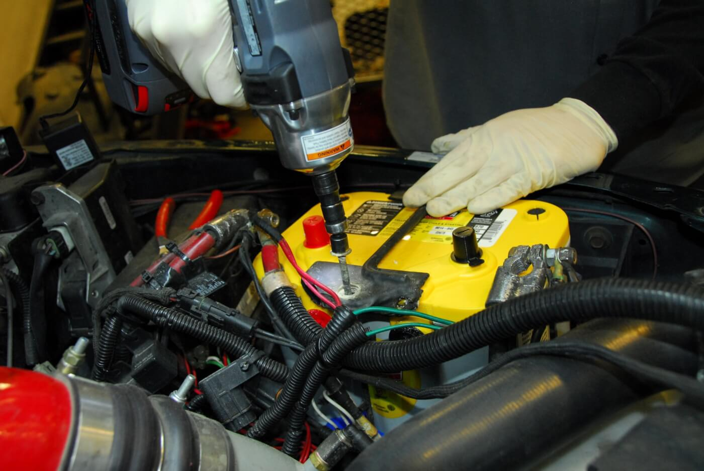 10. Use the factory hold-downs if possible to make sure the battery is secured. If they don't fit, Optima provides additional braces for the tray.