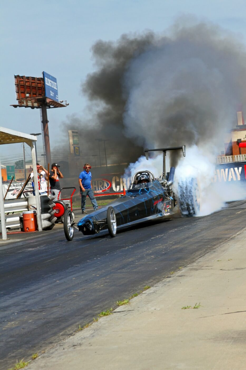 The Scheid Diesel dragster is an awesome sight and we love to shoot pictures of it flying down the track, but it's so much better in person. If you get a chance to go to one of the major diesel events you're likely to see it run and that alone is worth the price of admission.