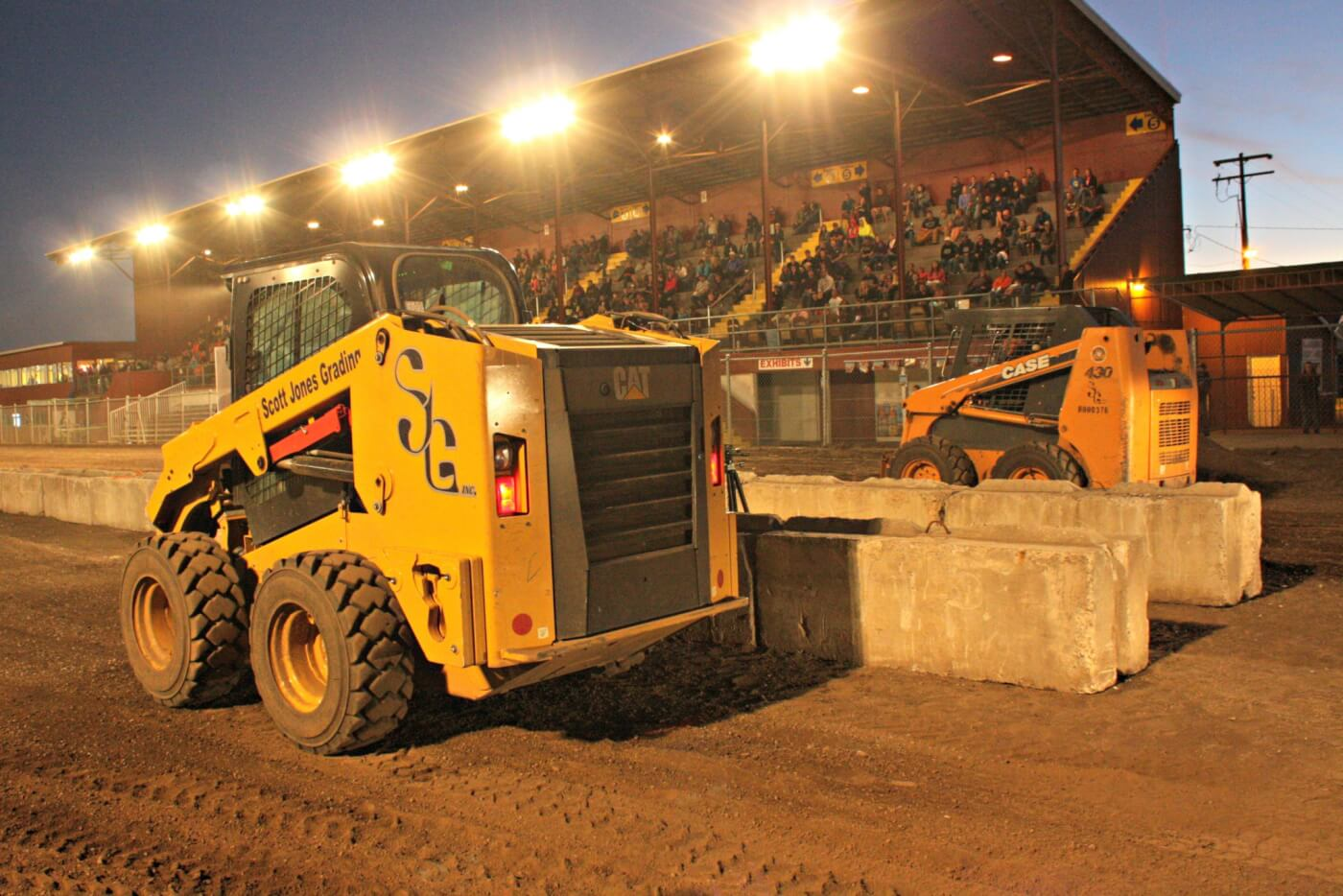 What would dirt drags be without a little skid/steer side-by-side action? With the front buckets off it was more of a wheelie fest than a drag race, but it definitely got the crowd's attention and was one of the best parts of the show.