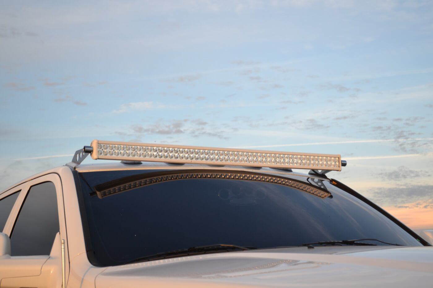 Since Joey heads to the coast on a regular basis, the lights in the grille weren't quite enough lighting when heading out into the dunes at night. To solve this, an additional light bar was mounted up on top of the truck from Rigid Industries.