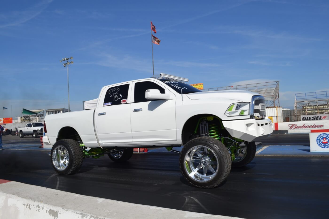 At the track, Joey's Ram rockets off the line with 1.8-second 60-foot times thanks to the 4.88 gears. Despite the heft, aerodynamic resistance, and rotating weight, the truck regularly clicks off mid '13s at the drag strip (with barely any smoke).