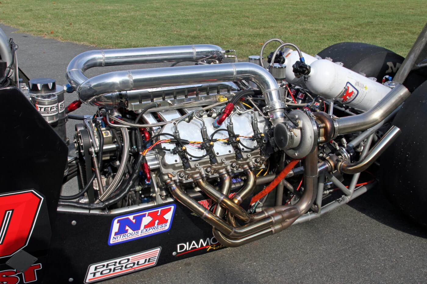 The 400 cid parallel twin turbocharged Duramax is the heart of the beast making an estimate 2,100 HP. The equal length tube headers are a work of metal crafting art and a unique sight to see on a diesel engine.