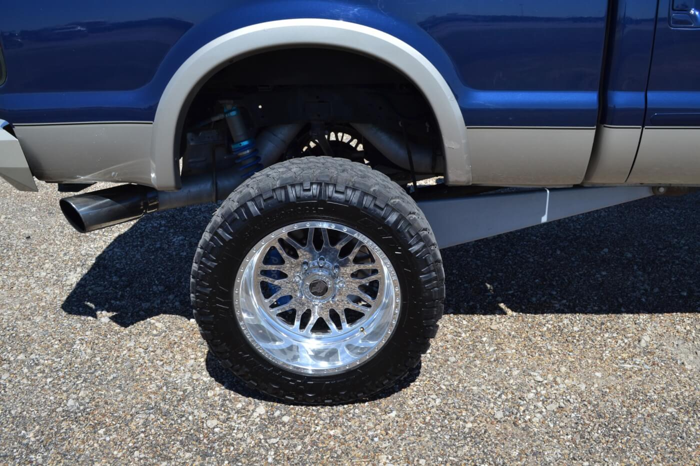 While it might look like the truck has enormous traction bars, the links are actually part of the four-link suspension that provides 8 inches of lift. The rear leaves have been removed completely, and instead, dampening is provided by King coilover shocks.