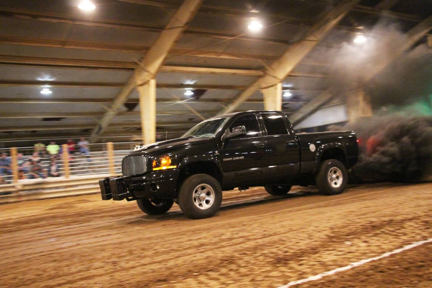 With some serious mph built up by mid-track, Brian Randall led the field in the Hot Street class with a 344-foot pull. His '06 Dodge sports three turbos, two 12mm CP3's, 250 percent over injectors, and is driven on the street. It's a textbook example of what the Hot Street class is all about: a class that provides high horsepower, street-legal, unlimited turbo trucks a category to compete in.