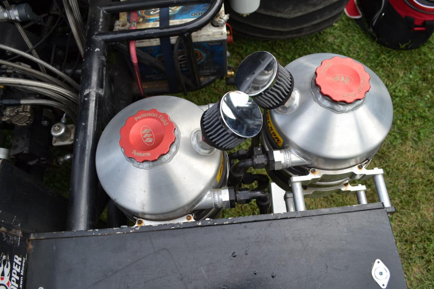 The oiling system for the Duramax system is quite complex, and uses an external wet sump system. Up front, four Peterson tanks (two on each side) hold oil for both the engine and turbo systems, as well as diesel fuel, and water for the water injection system.