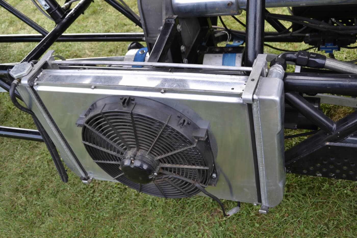 Although the block has been filled, Kyle still used a cooling system to circulate water through the heads. Since then, he's found the engine to be reliable without it, so the radiator has now been deleted.