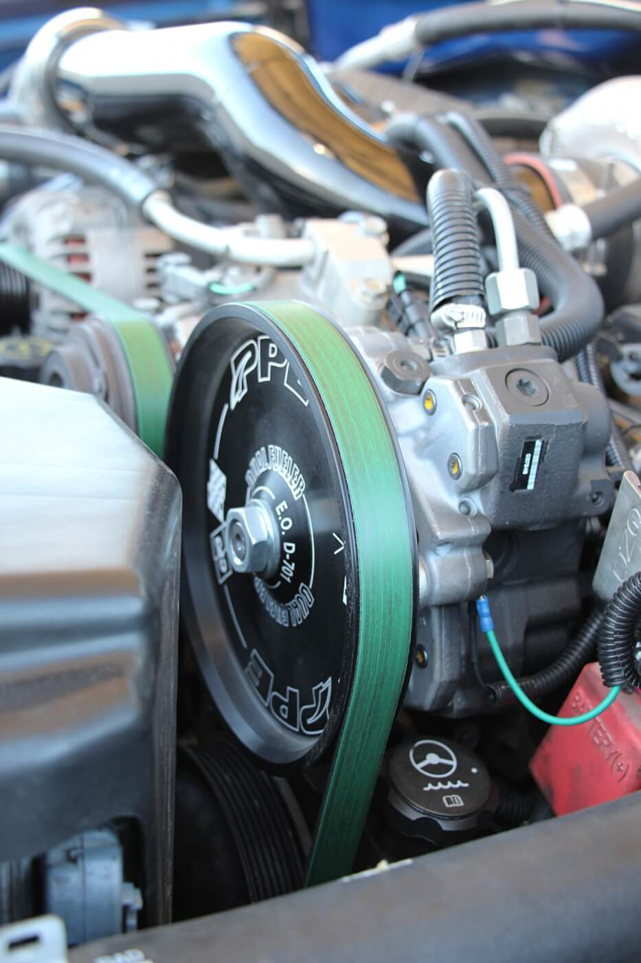 With 100 percent over injectors from Exergy Performance to feed, a PPE Dual Fueler CP3 kit was installed. Matt sourced both brand new pumps from his local GM dealer. An LB7 CP3 sits in the factory location, with an LBZ pump getting belt driven up top.