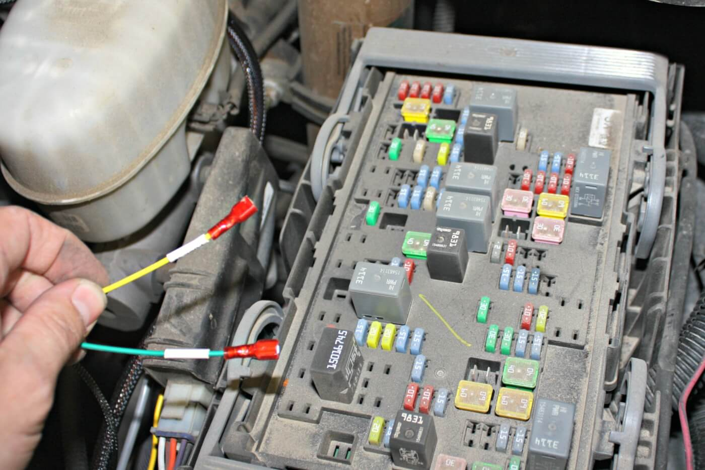 12. Inside the under hood fuse box, the Edge Juice system will use two wires connected to fuse jumpers that will allow the kit to be setup with a Turbo Timer. The turbo timer can be setup to idle the engine even after you've shut the key off and stepped out of the truck until a pre-set time or EGT is reached. This helps the engine come down to a safe shutdown temperature prolonging component life, like turbocharger bearings.