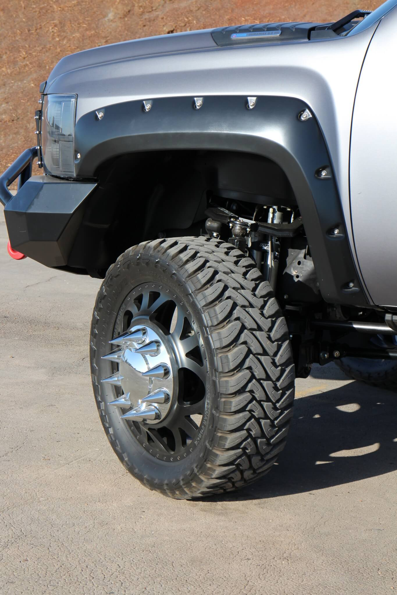 """The dually rolls on a set of American Force Weapon forged aluminum 24x8 satin black wheels with Toyo 37x13.5 Open Country M/T rubber. Notice the wicked """"spike"""" lug nuts."""