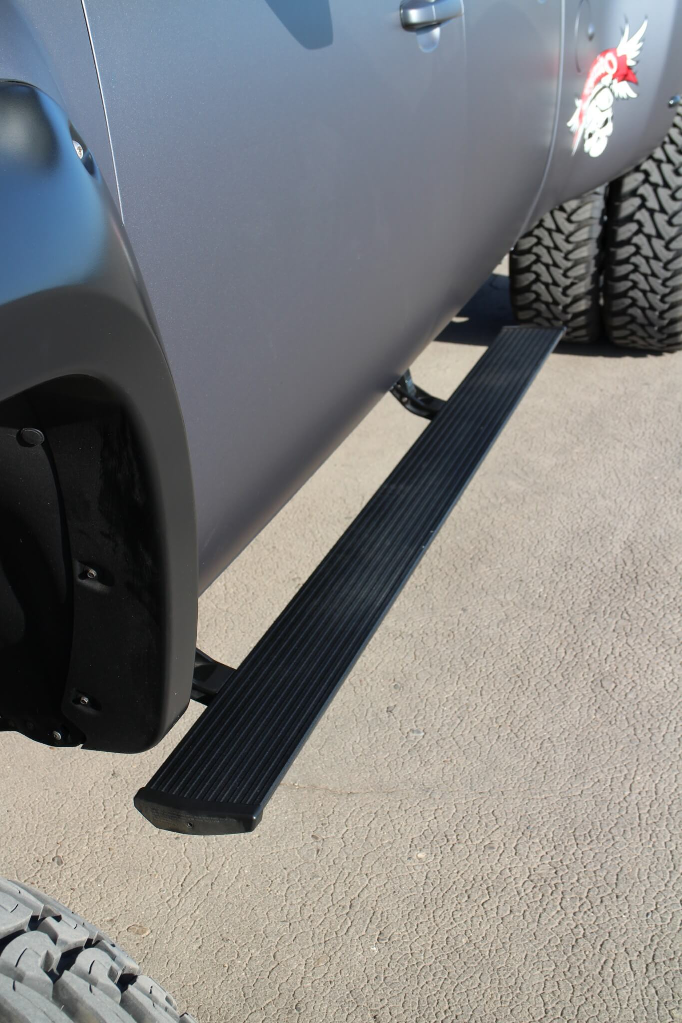A pair of AMP Research retractable PowerSteps helps with easier access to the cab.