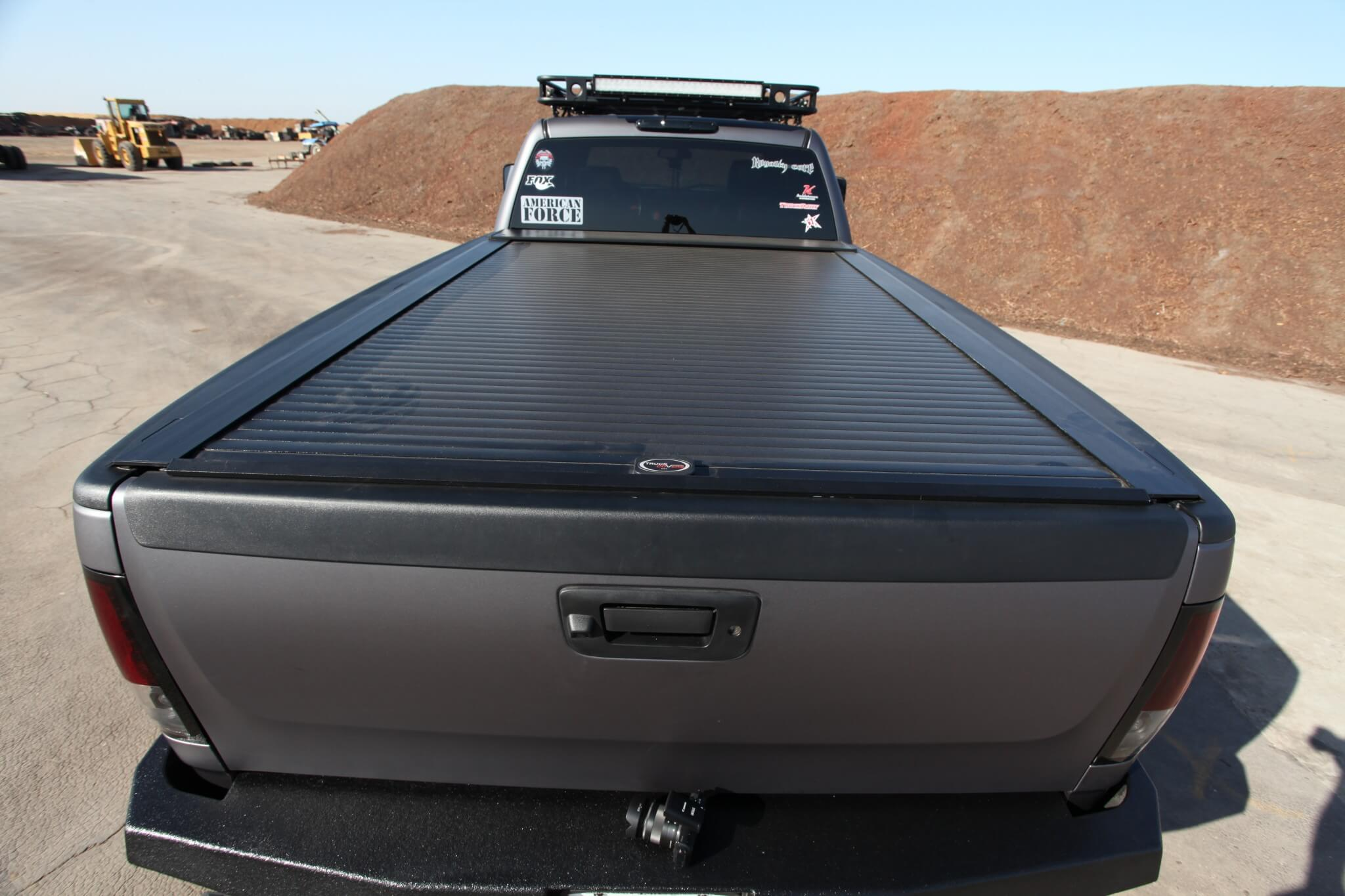 A retractable USA tonneau cover secures the bed's payload.
