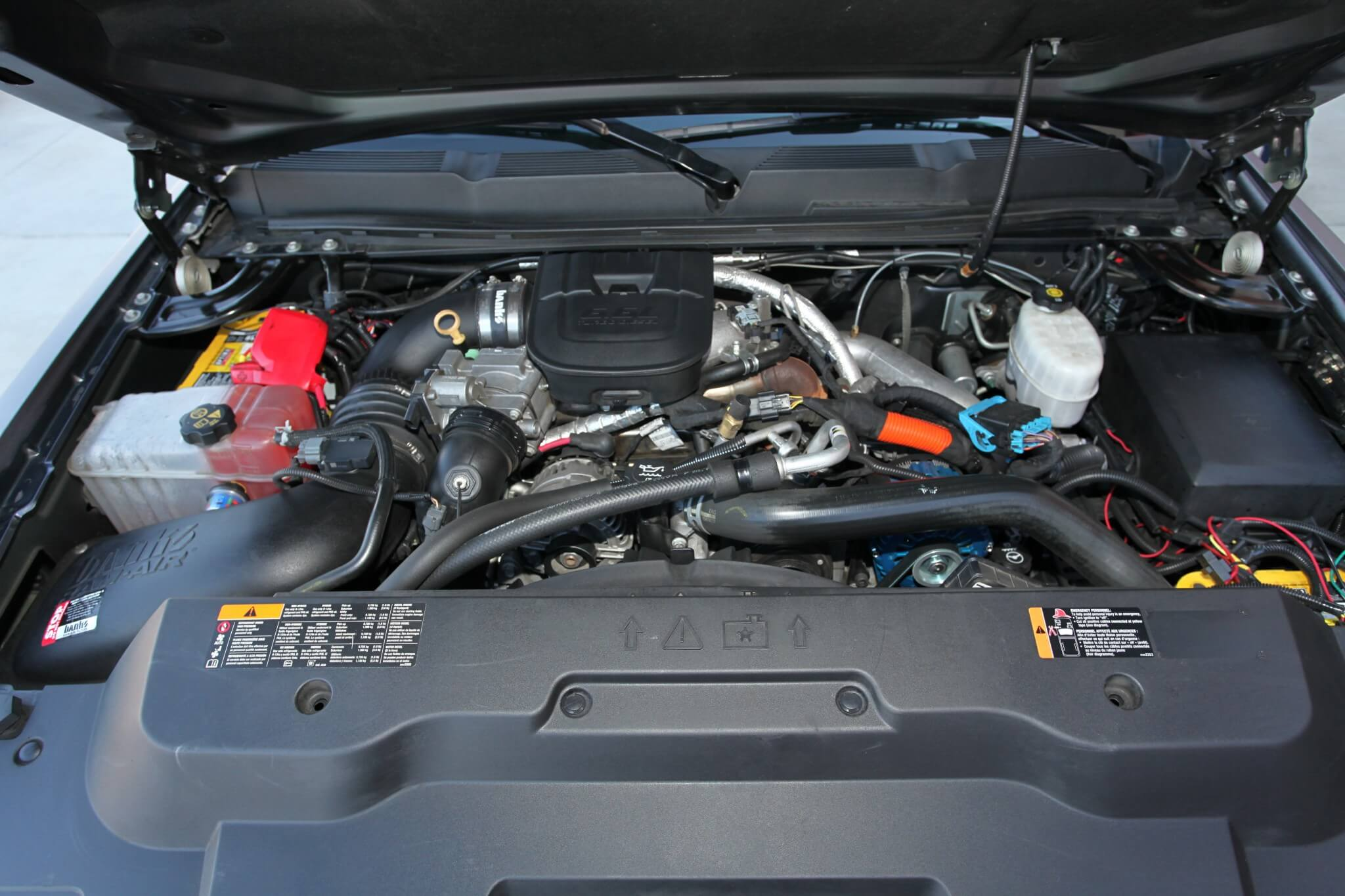 Lifting the hood exposes the mighty Duramax 6.6L turbo diesel that's equipped with a Banks cold air intake and tuned by an H&S Mini Maxx programmer.