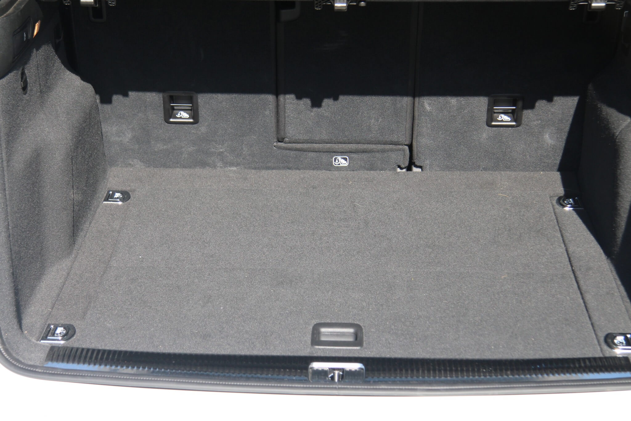 The Q5 offers a large cargo space in the hatch area. Also note the split 60/40 rear seats and the pass-through rear center console area that expands cargo-carrying capabilities.
