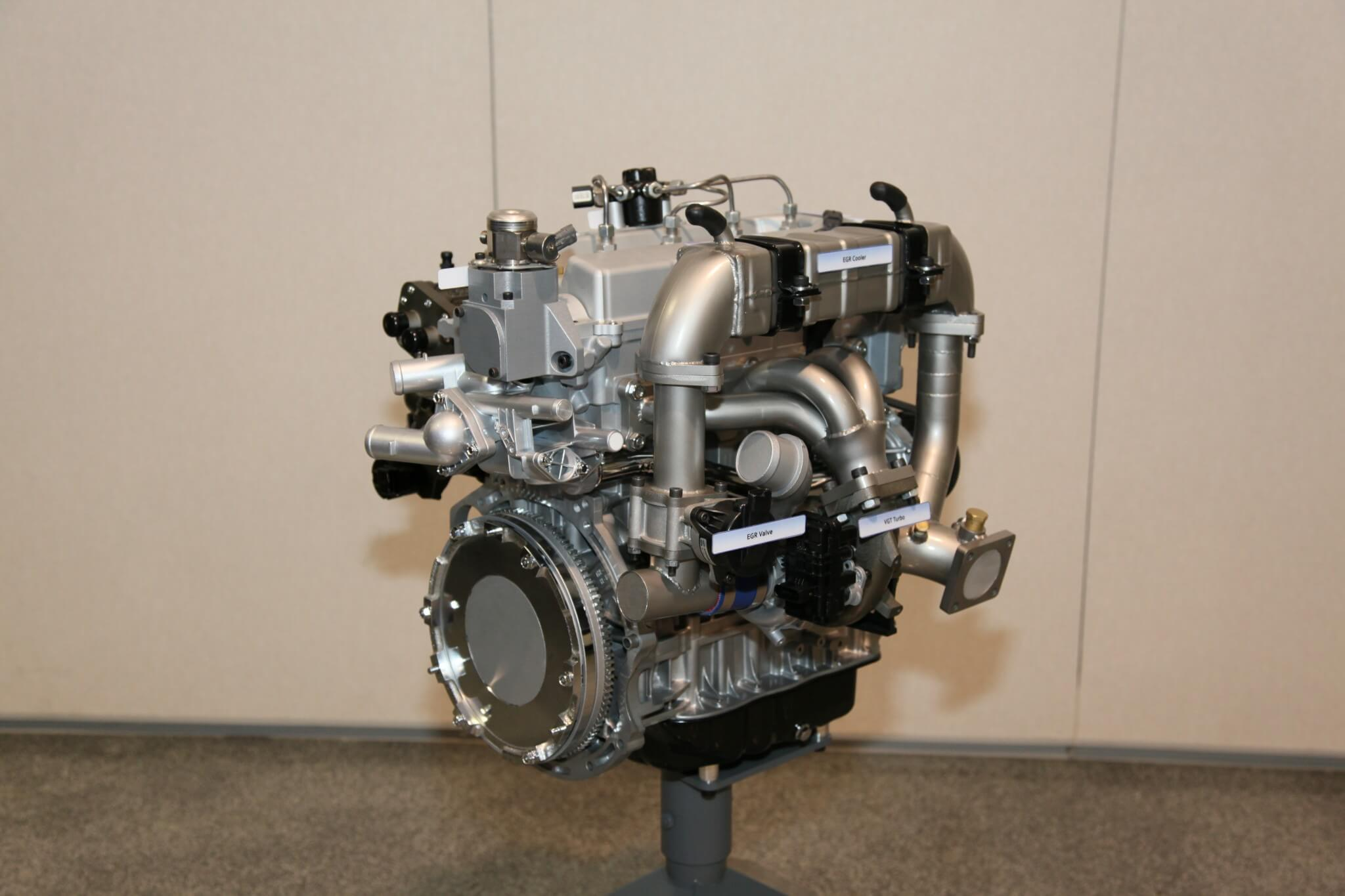 1. Looking similar to a diesel engine, Hyundai's diesel uses gasoline as fuel. Note the massive EGR cooler abutting the cylinder head. The engine is running 30 to 40 percent EGR to assist in lean-burn conditions. Not as visible is the common-rail fuel system.