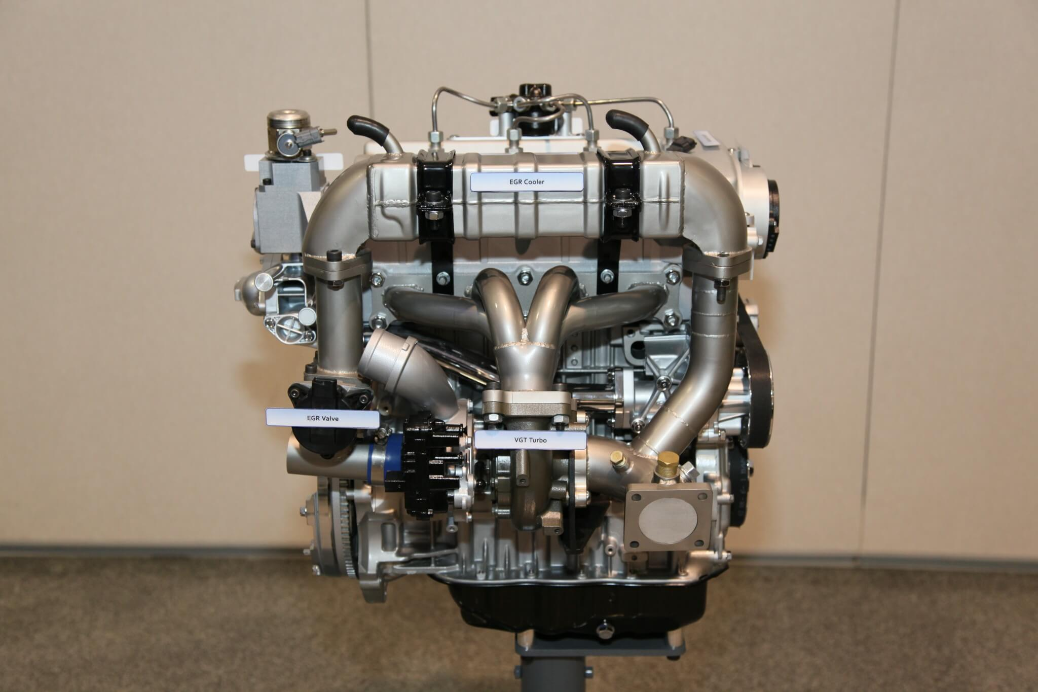 2. A side view clearly displays the massive EGR cooler, EGR valve, and the variable geometry turbocharger. Hyundai uses twin-scroll turbos for many production engines so the use of a VGT turbo is significant.