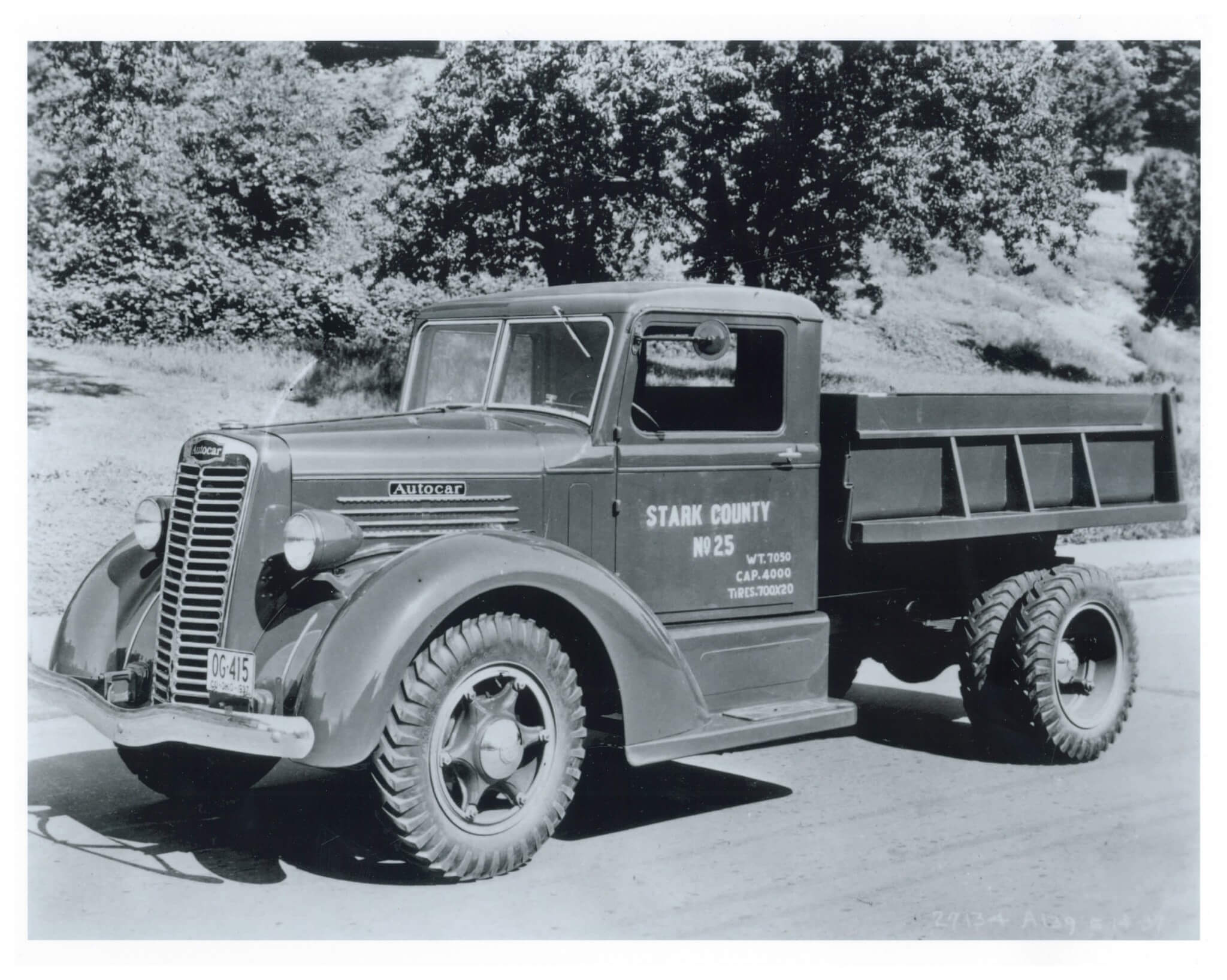 The 1930s found truck makers following the styling lead of their automotive cousins. Note the unique front end styling cab treatment on this county-operated Autocar medium-duty dumptruck.