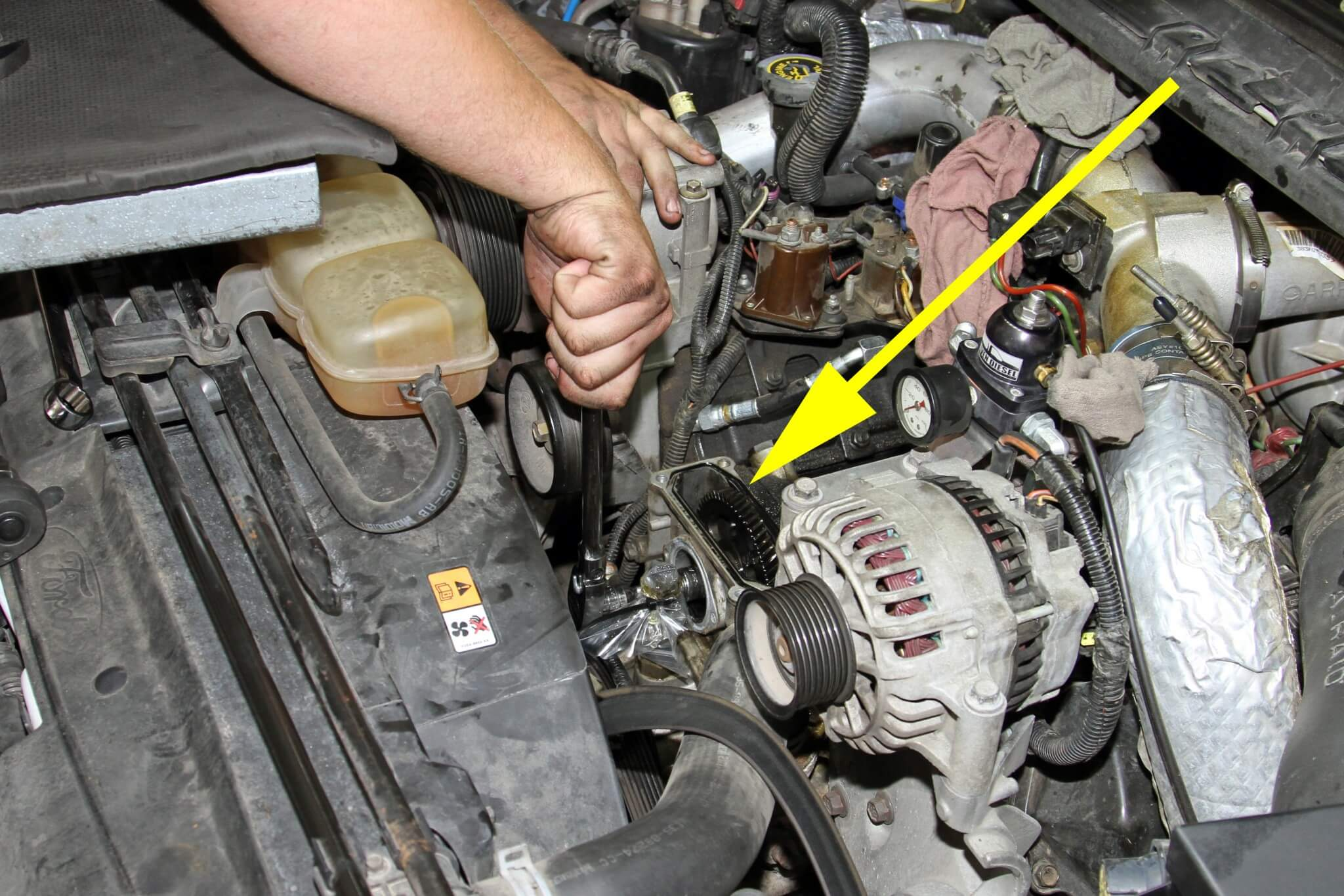 15. The HPOP drive gear bolt may require a significant amount of force to be removed. It's also a tight fit with the socket and ratchet between the coolant fitting and gear housing, as seen here.