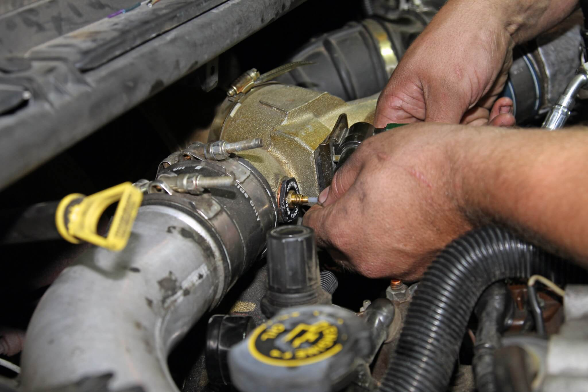 20. The nylon tubing for the boost gauge connects directly to the supplied fittings. Be sure to install the small ferrule or the tubing will not seal. Carter covers the nylon tubing with a protective sheath to prevent it from being damaged under the hood.