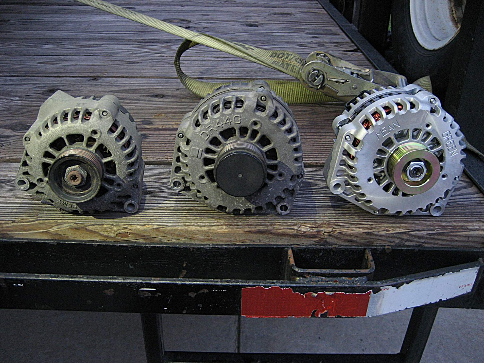 Here you can see the stock OEM alternator on the left. In the