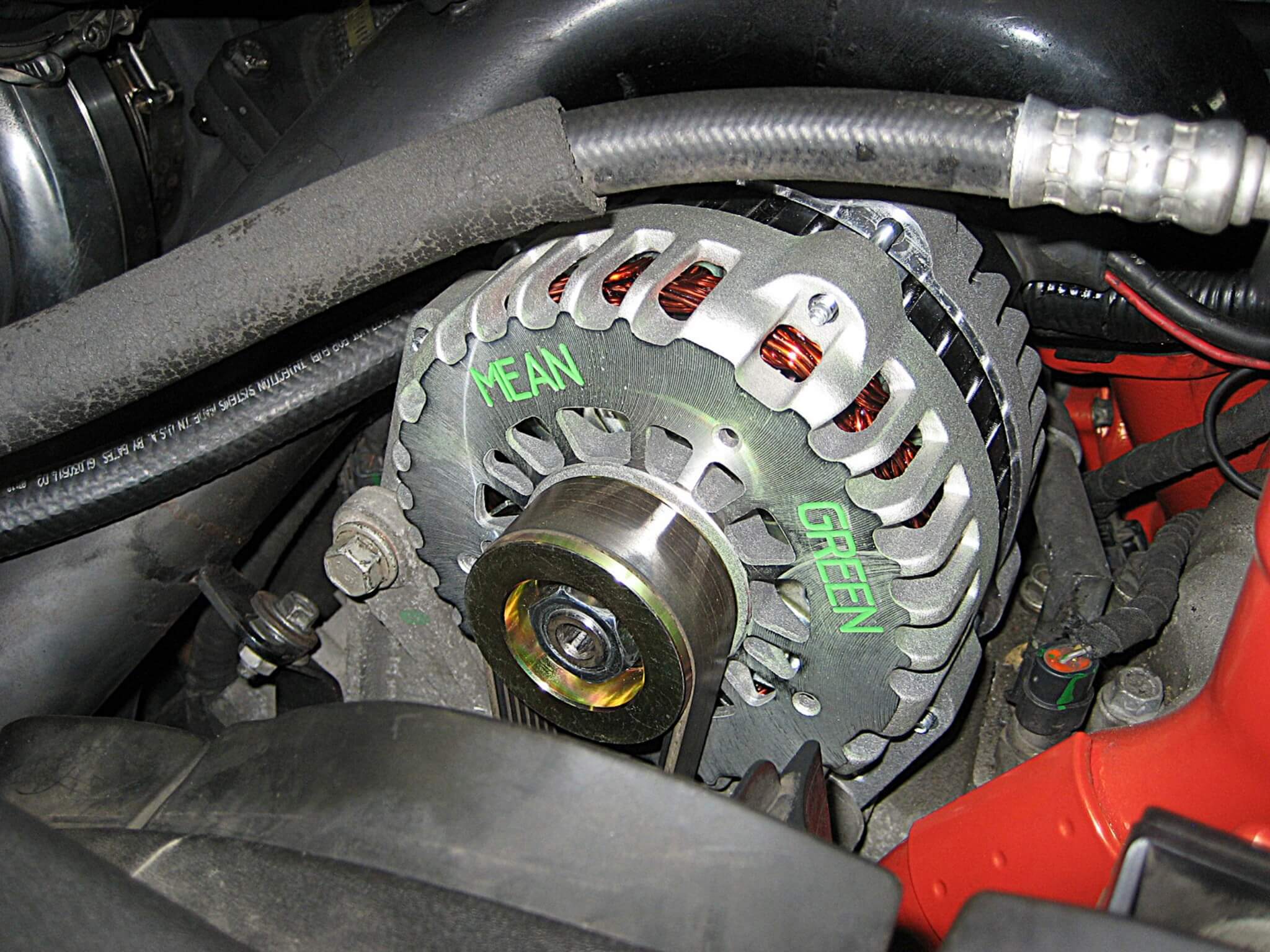 The Mean Green alternator fits nicely in stock OEM mounting brackets. The  install