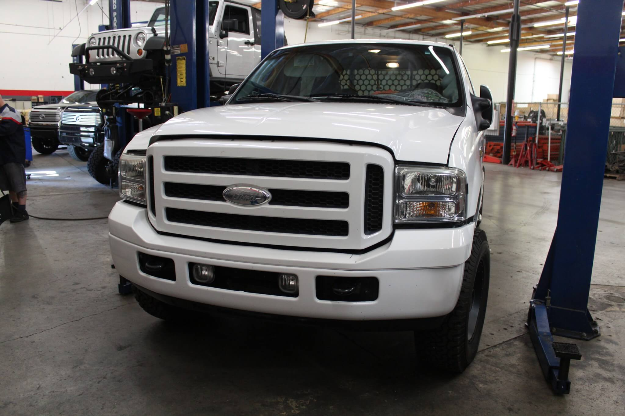 1. The subject of our nose job is a 2006 Super Duty. It's already equipped with lots of nice accessories but the front of the truck is pretty pedestrian. The owner of the truck wanted to fix that.