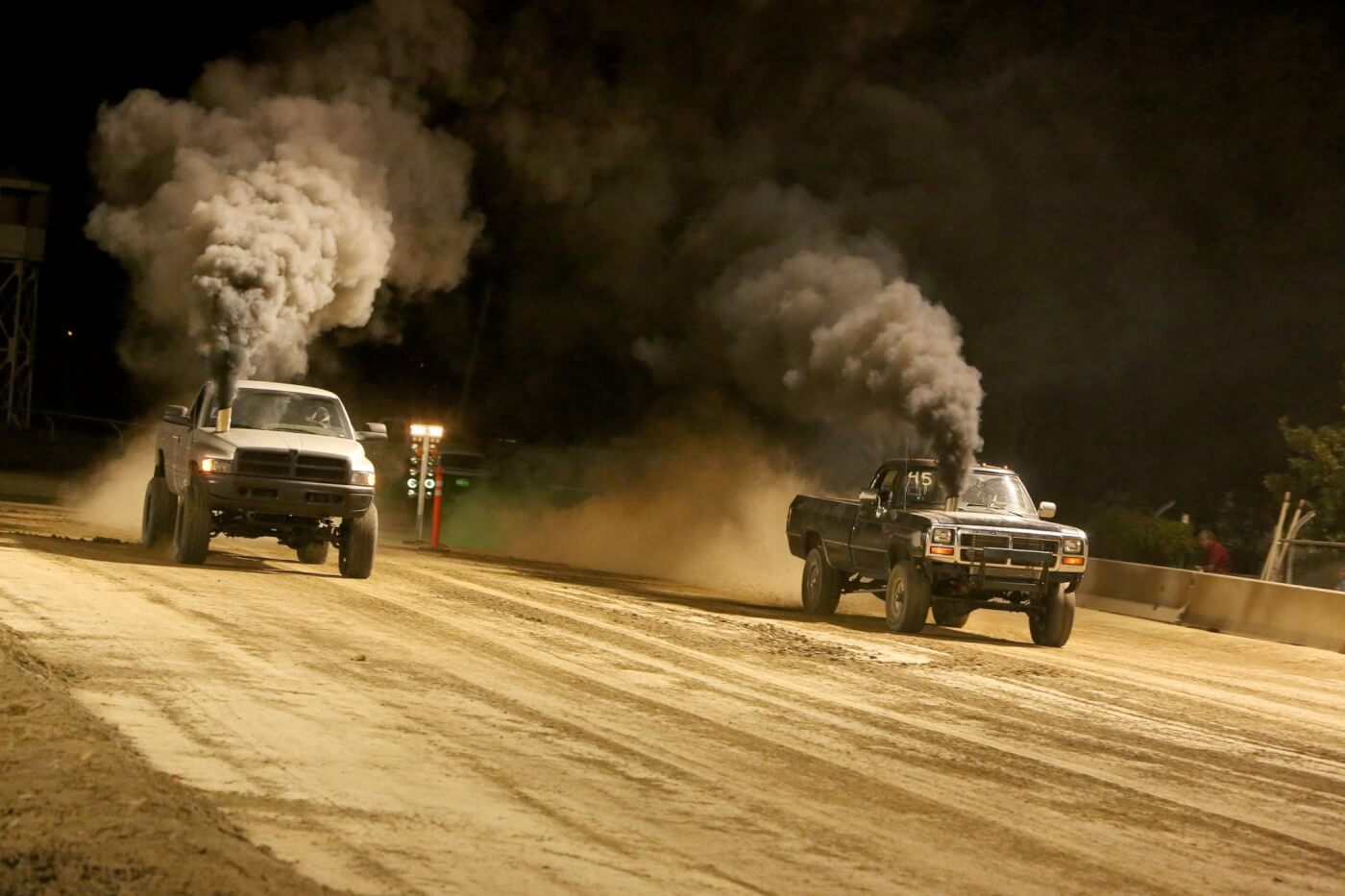 The dirt drags ran late into the night and made for a great show for the crowd. These two big Cummins trucks may not be completely street legal thanks to those awesome hood stacks, but that won't keep them from having some fun off-road.