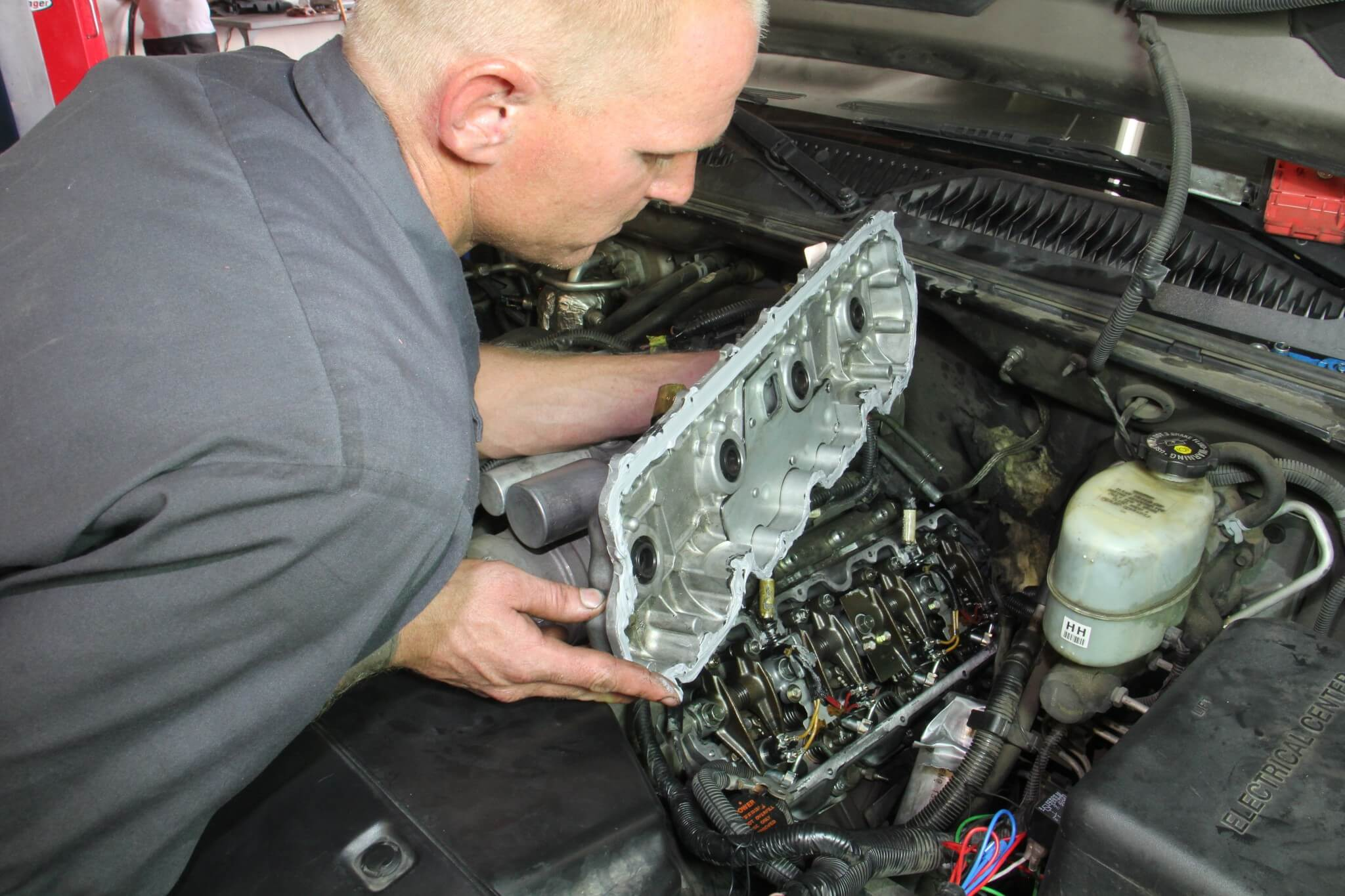 5. After removing the fuel lines from the injectors and fuel rail, a 10mm socket was used to remove the top valve cover bolts from the bottom valve cover base.