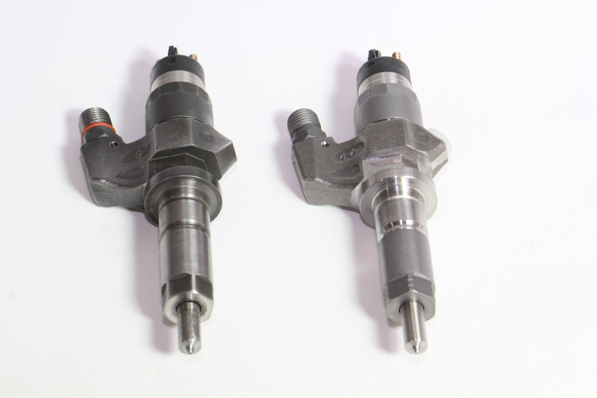12. This image shows the old injector (left) and new Bosch injector (right). Quality is not always visible at first glance, but it's seen in engine performance right away. Don't skimp here; all replacement injectors are not the same, as this owner found out the first time around.
