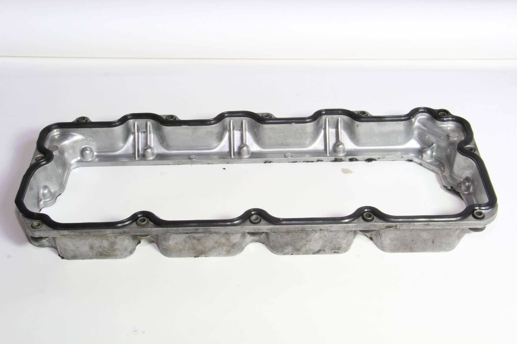 16. Before installing the bottom valve cover, the base rubber gasket was glued into position and allowed time to cure before being installed to the head surface.