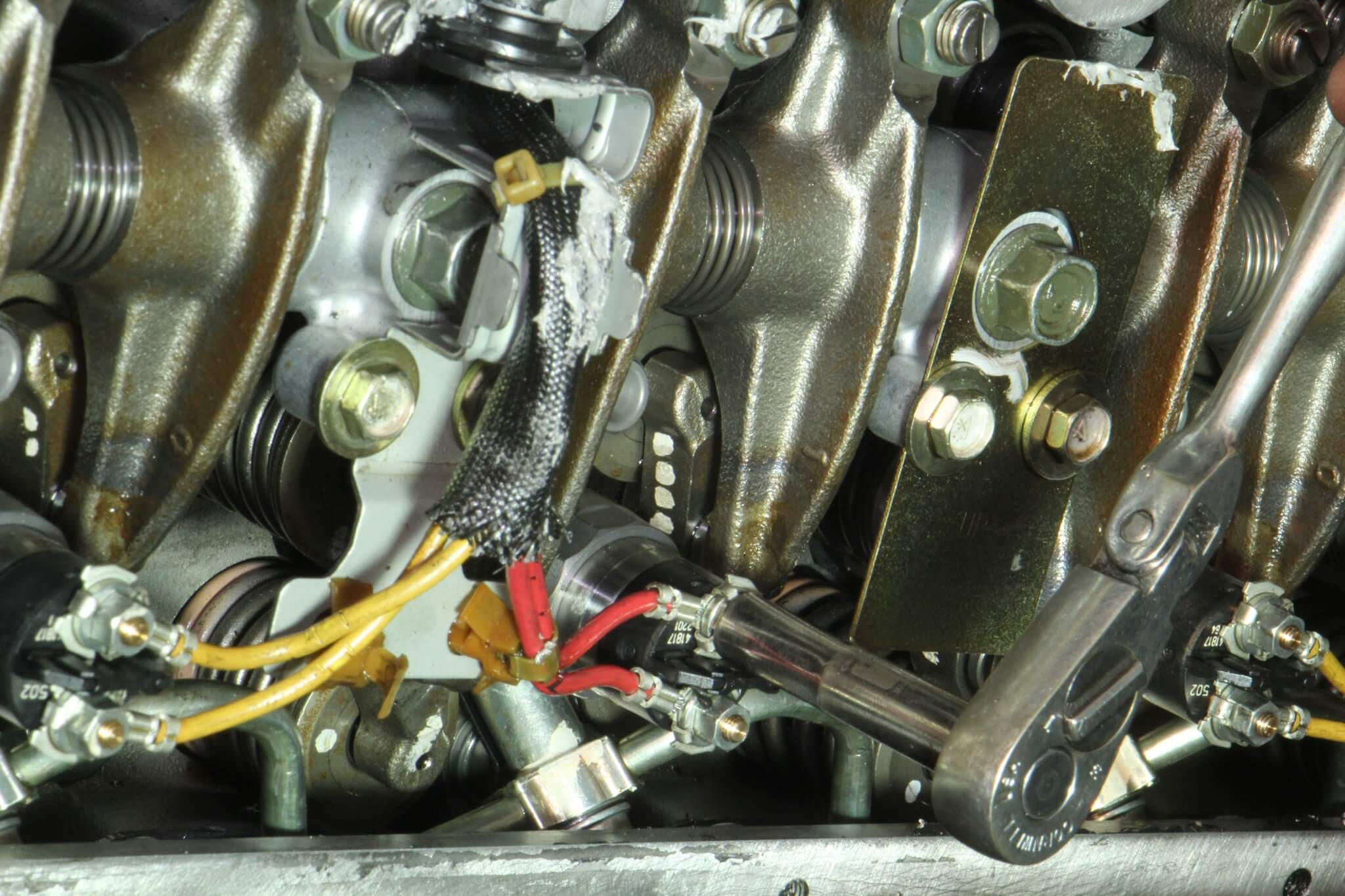7. The injector solenoid wires were removed using a 7mm socket.