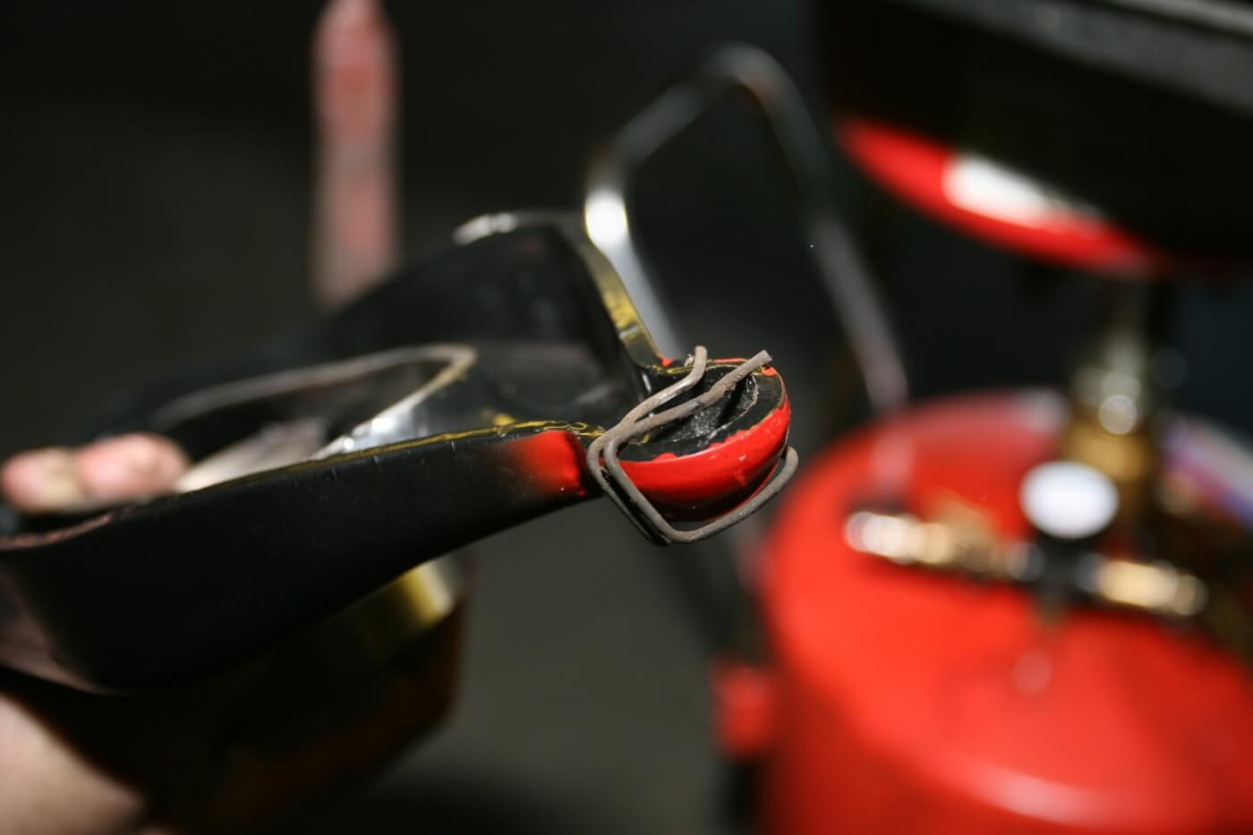 7. Anthony removed the retainer clip and reinstalled it on the painted end of the new clutch fork.