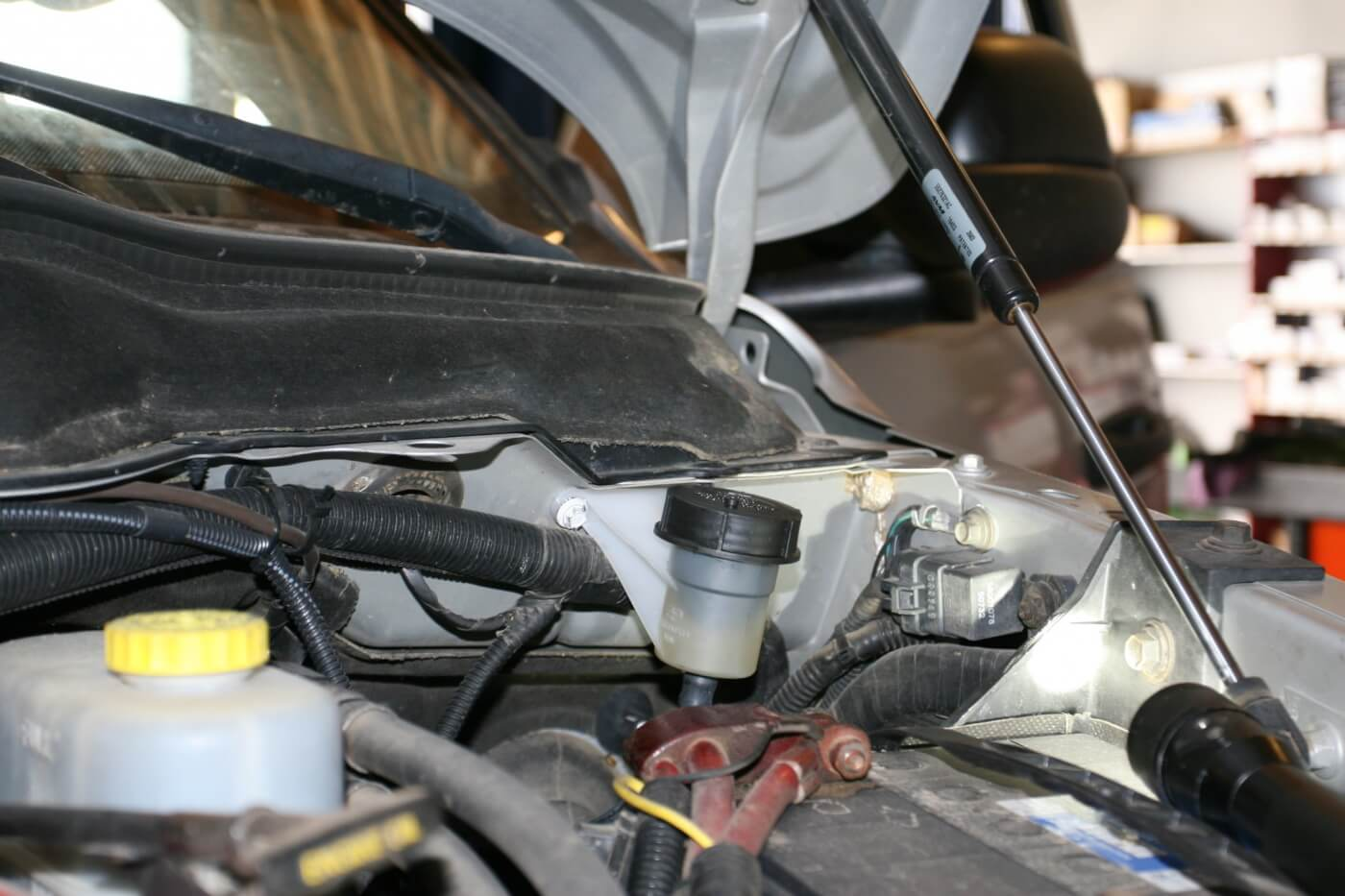 20. After mounting the hydraulic fluid reservoir in a convenient location on the firewall, the clutch pedal is adjusted so it's even with the brake pedal.