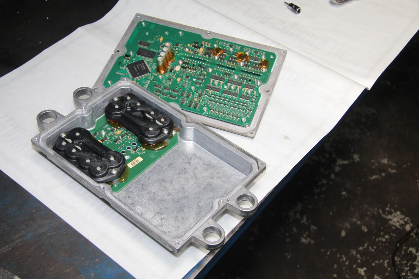7. This is the inside of a stock FICM. When upgrading just the power supply, the upper half of the case and the control board are retained. Replacing the entire unit is always an option, but more often than not it's the power supply, rather than the control board, that's the source of the problem.