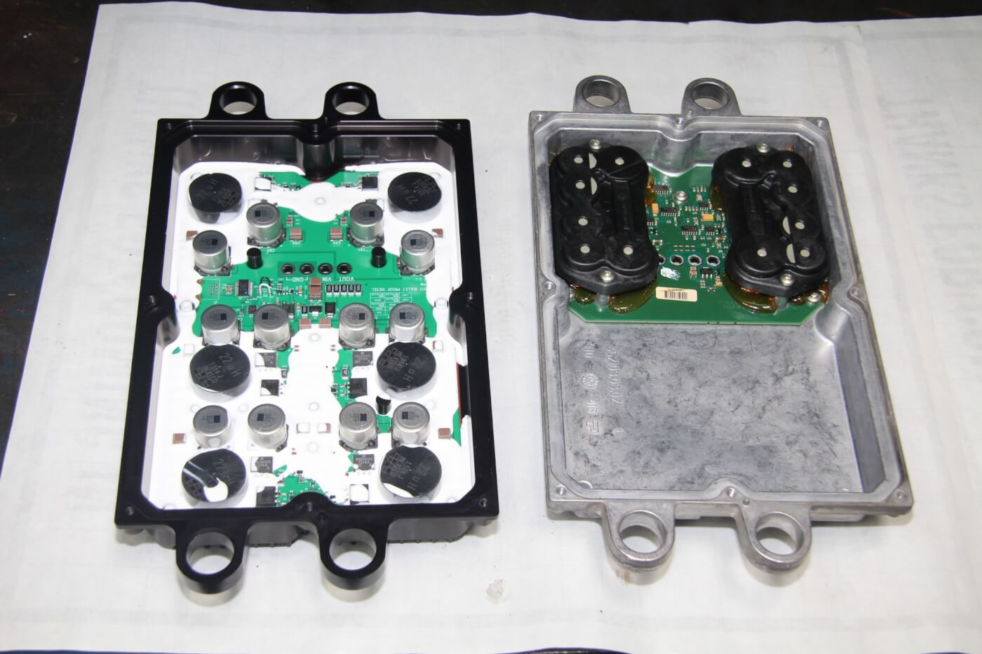 8. Here we see the Bullet Proof FICM power supply on the left and the OEM unit on the right. The Bullet Proof part seen here has the six-phase upgrade. Both four- and six-phase Bullet Proof power supplies are superior to the OEM unit.