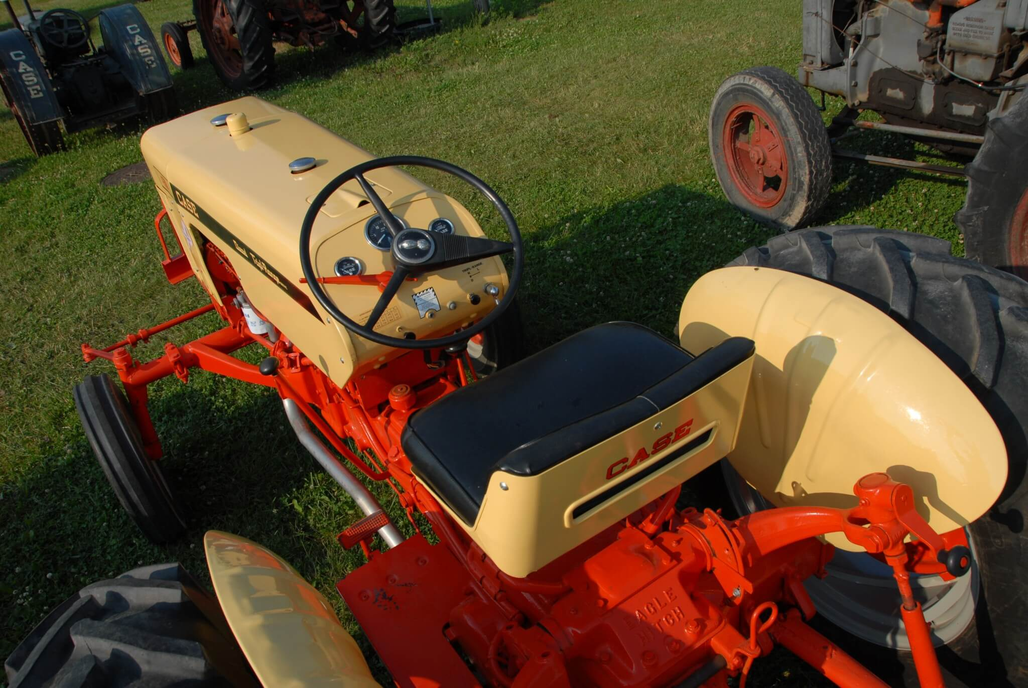 There was nothing particularly impressive about the 430's seating arrangement. The seat was a little better than most but without a substantial back. The controls were well positioned, though. Note the hand clutch, the long lever to the left of the steering wheel. In the rearward position, the transmission was disengaged but the PTO retained power flow. This enables the tractor to be stopped without interrupting power to PTO-driven implements.