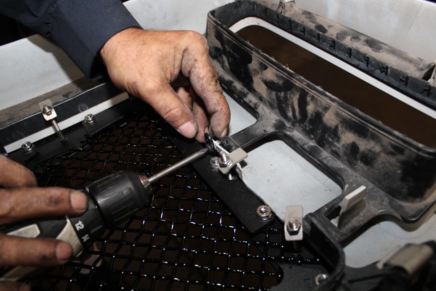 13. In addition to the tabs, the insert attaches to the factory shell using screws and metal tabs that are supplied with the kit. The Royalty Core insert is surprisingly heavy, and using all of the available attachment hardware helps ensure that it stays secure.