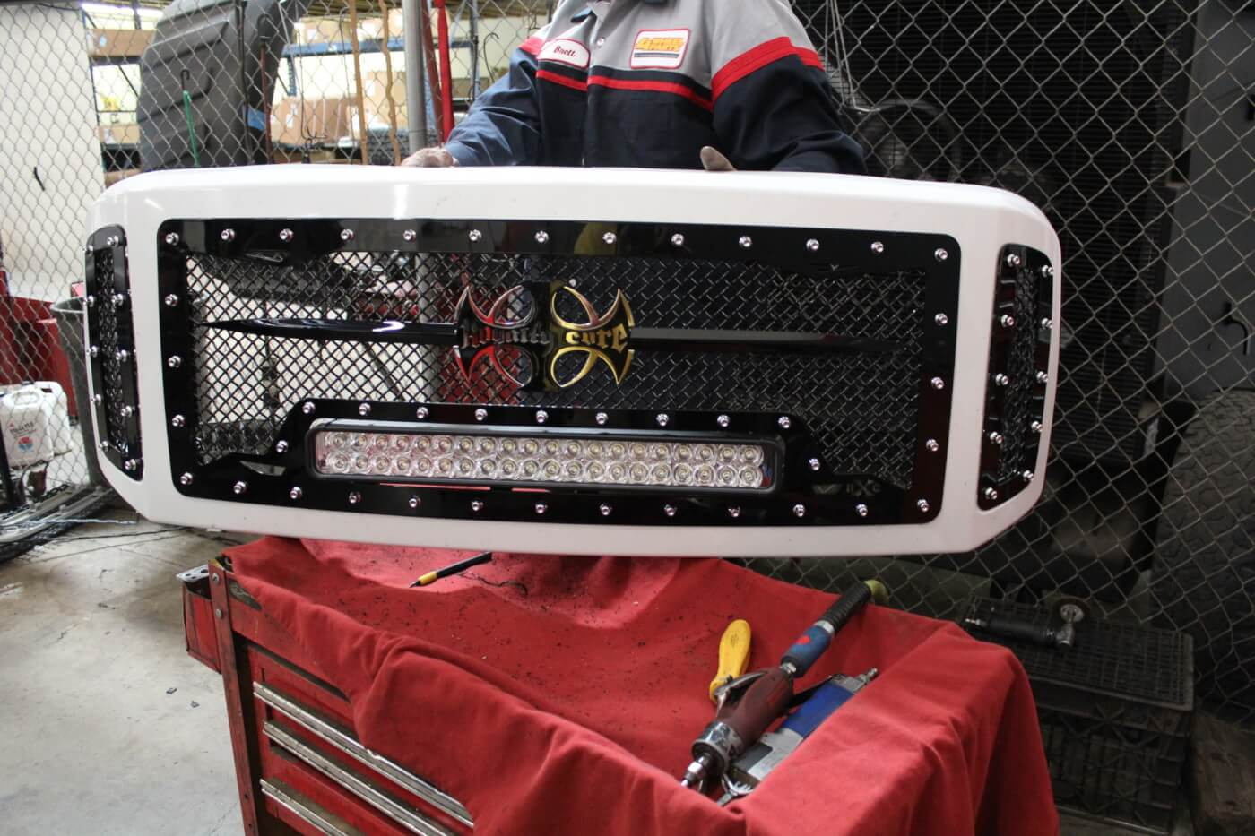 15. It took some work, but the finished insert is worth the effort. Not only does it look mean, but there's a 22-in. LED light bar built right into the grille!