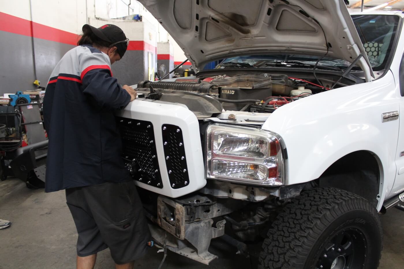 16. Once assembly is complete, reinstalling the grille assembly is a simple matter. The grille can be installed with the factory bumper in place, but removing it will make the job much easier. If you have an aftermarket bumper, removal will most likely be mandatory.